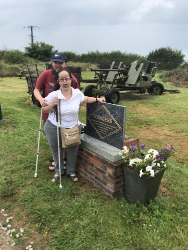 Tony and Tatiana next to a marble memorial to the 5th Rangers Battalion who captured the gun batteries at Maisy on 9th June 1944.