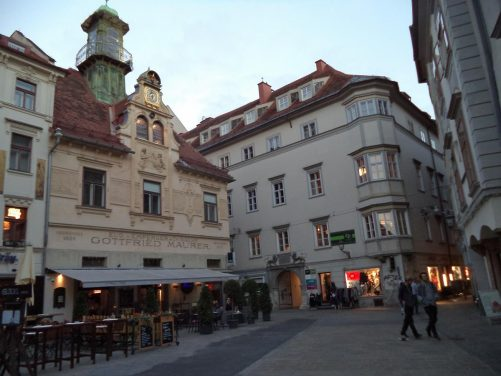 The Graz Carillon Glockenspiel. Located in the middle of Glockenspielplatz. It presents a small boy and girl in traditional costume, dancing to three different tunes. They appear at 11am, 3pm and 6pm.
