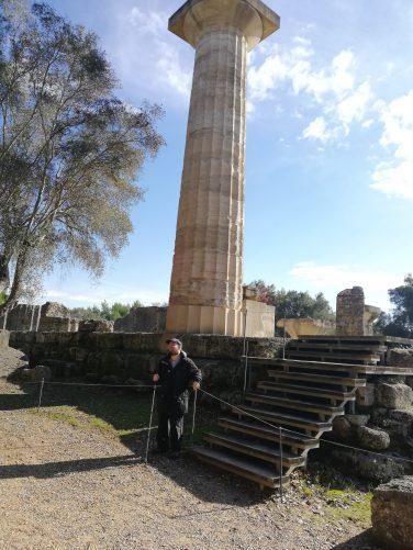 Tony below a large Doric stone column.