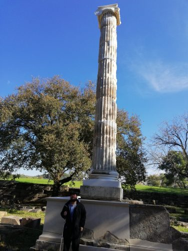Tony in front of another more slender Ionic column.