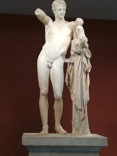 An ancient Greek sculpture of Hermes and the Infant Dionysos. It is also known as the Hermes of Praxiteles or the Hermes of Olympia. Discovered in 1877 in the ruins of the Temple of Hera, Olympia, Greece.