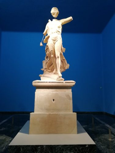 Marble statue of the Greek goddess of victory, Nike, standing on a pedestal. Carved by the sculptor Paionios in 425–420 BC.