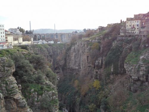 View along the ravine which is over 100 metres in depth. The River Rhumel only just visible at the bottom. In the distance is the Sidi Rached road bridge.