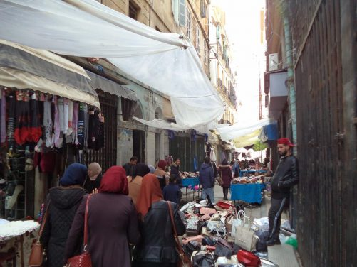 More market stalls, the one immediately in front selling hand bags.