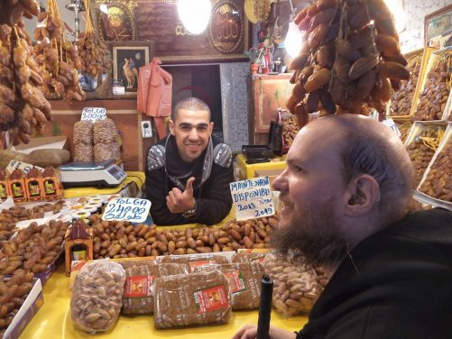 Tony at a small shop/stall selling dates.