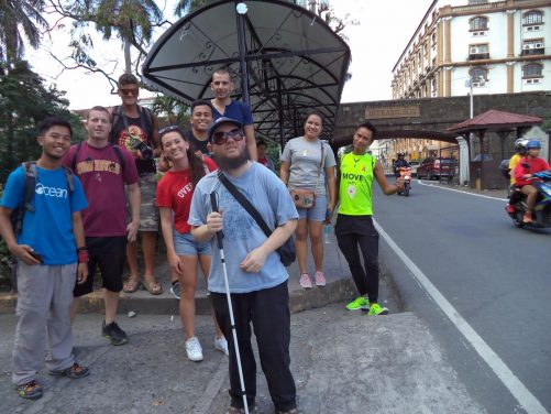 Tony with a group at the entrance into the historical walled district of Intramuros. The group is a mix of Filipino couchsurfers and their foreign guests. Intramuros means