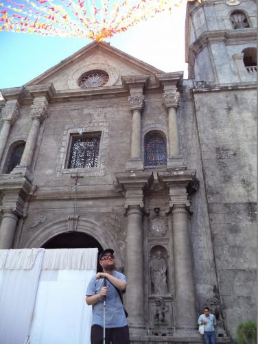 View of the Baroque façade of San Agustin Church. A screen in front of the main entrance.