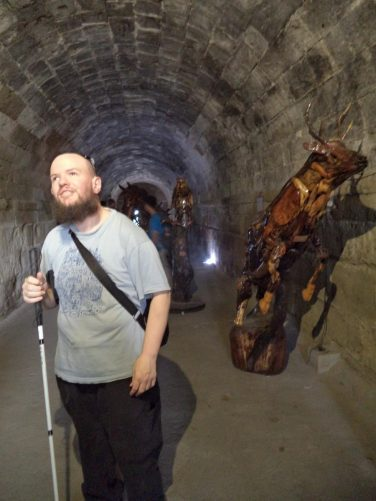 Tony in a stone-lined tunnel at Baluartillo de San Francisco, part of the defensive walls around Intramuros. These tunnels were used as storage chambers.
