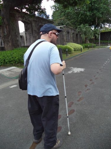Tony with a trail of footprints on the tarmac in front of him. These prints show the last steps taken by José Rizal, Filipino national hero and revolutionary, en route to his execution spot by Spanish firing squad in 1898.
