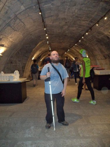 Objects on display inside a tunnel at Fort Santiago, including Lego models of historic buildings.