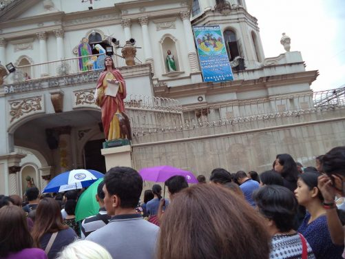 Crowd of people outside the Minor Basilica of the Black Nazarene (also known as Quiapo Church) located in Quiapo district. The basilica is famous for the Black Nazarene, a dark statue of Jesus Christ said to be miraculous.