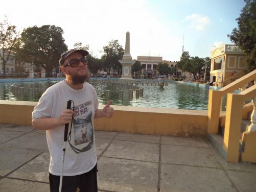Tony in Plaza Salcedo in front of a large rectangular formal pond. This lively plaza is in front of St Paul's Cathedral. It is named after the Spanish conqueror, Juan de Salcedo, who founded the Spanish settlement here in 1572.
