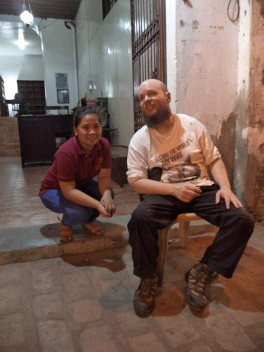 Tony with a girl who works at Escolta's Homey Lodge, an old Spanish colonial mansion converted into a comfy guesthouse. It is located directly on Calle Crisologo Street.