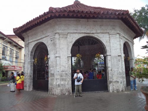 Tony in Plaza Sugbo outside an octagonal building that houses Magellan's Cross. Portuguese conquistador Ferdinand Magellan is said to have ordered the planting of a wooden cross here in 1521 upon converting the original inhabitants to Christianity. The current cross is said to encase the remains of that original cross.