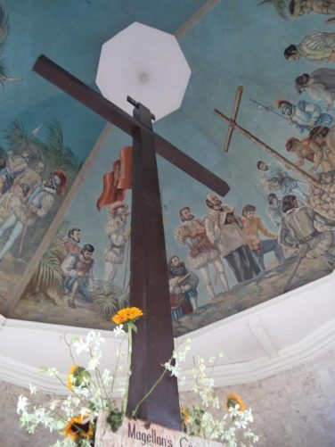 Looking up at the cross and the ceiling above which is painted with murals depicting the planting of the cross in 1521.