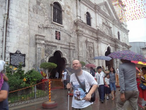 Tony outside the entrance to the Basilica of Santo Niño. The basilica was founded in 1565 and is the oldest Roman Catholic church in the country.