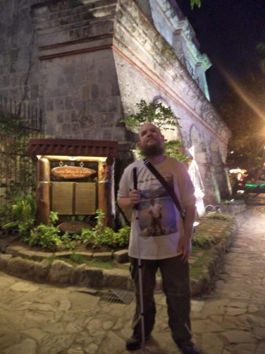 Tony with the walls of Fort San Pedro lit up behind.