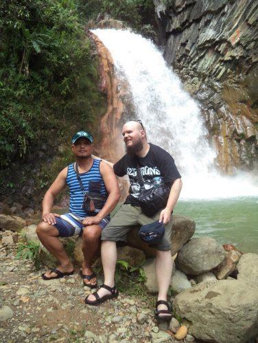 Tony sitting on the rock with a Filipino guy named Fernando.