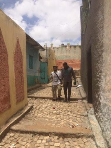 Brother Tony and brother Aja in a narrow cobbled street near to one of the mosques.