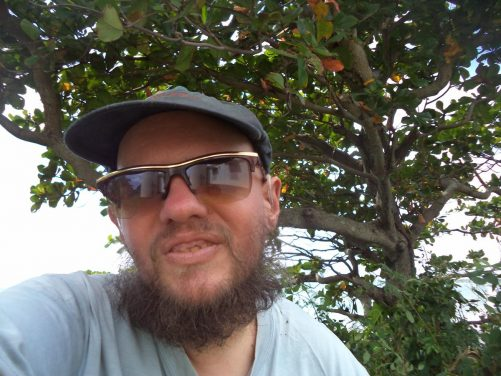 Selfie of Tony taken while standing under a tree.