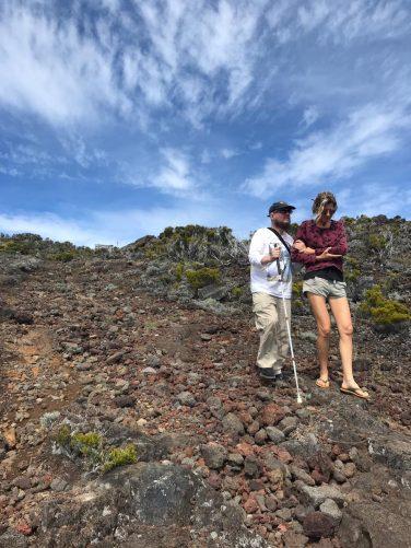 Tony and Marie hiking down Piton de la Fournaise volcano.