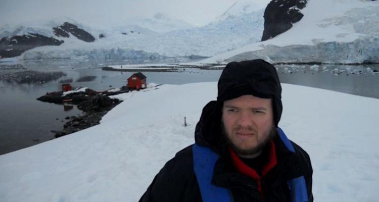 Tony walking through the snow above Paradise Bay, Antarctica, January 2011.