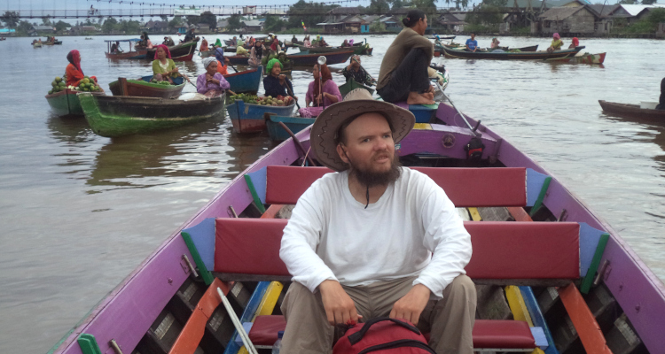Tony in a small local boat, floating market in Banjarmasin, South Kalimantan, Indonesia, February 2015.